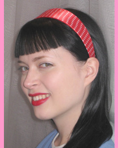 Red Head band with white polka dots